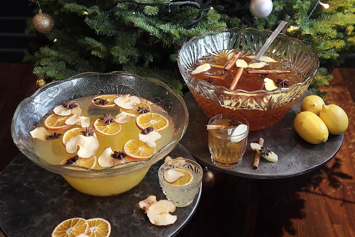 (From far left) Christmas Punch, Gingerbread Punch and Stone Fence Punch (above). 28HKS bar captain Lukas Kaufmann uses rum, champagne cordial and Becherovka, a Czech herbal liqueur from his home country. 28HKS floor captain Danny D'Cecil built the p