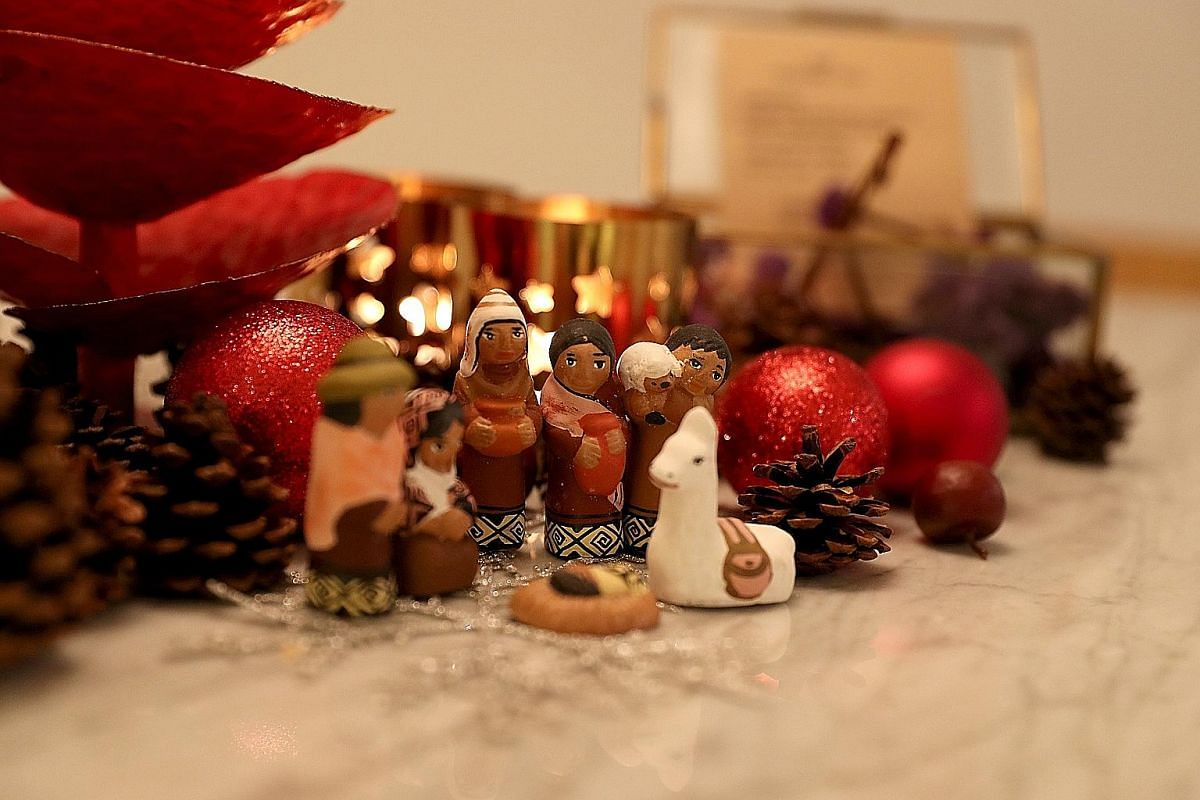 Ms Sharon Lee and her husband Christophe (above) host a Christmas party for about 50 friends every year. They set the mood with subtle touches, such as displaying miniature figures.
