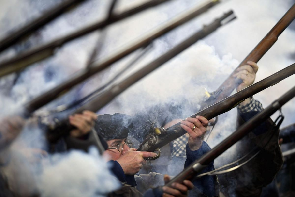 The end zone militia fire their muskets prior to the game between the Minnesota Vikings and the New England Patriots at Gillette Stadium on December 2, 2018 in Foxborough, Massachusetts. PHOTO: GETTY IMAGES/AFP