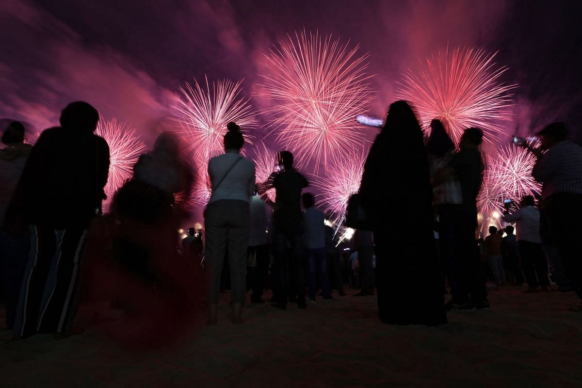 People watch fireworks illuminate the sky over the Corniche of Abu Dhabi as a performance to celebrate the UAE's 47th National Day and the Year of Zayed in Abu Dhabi, United Arab Emirates, December 2, 2018. PHOTO: EPA-EFE