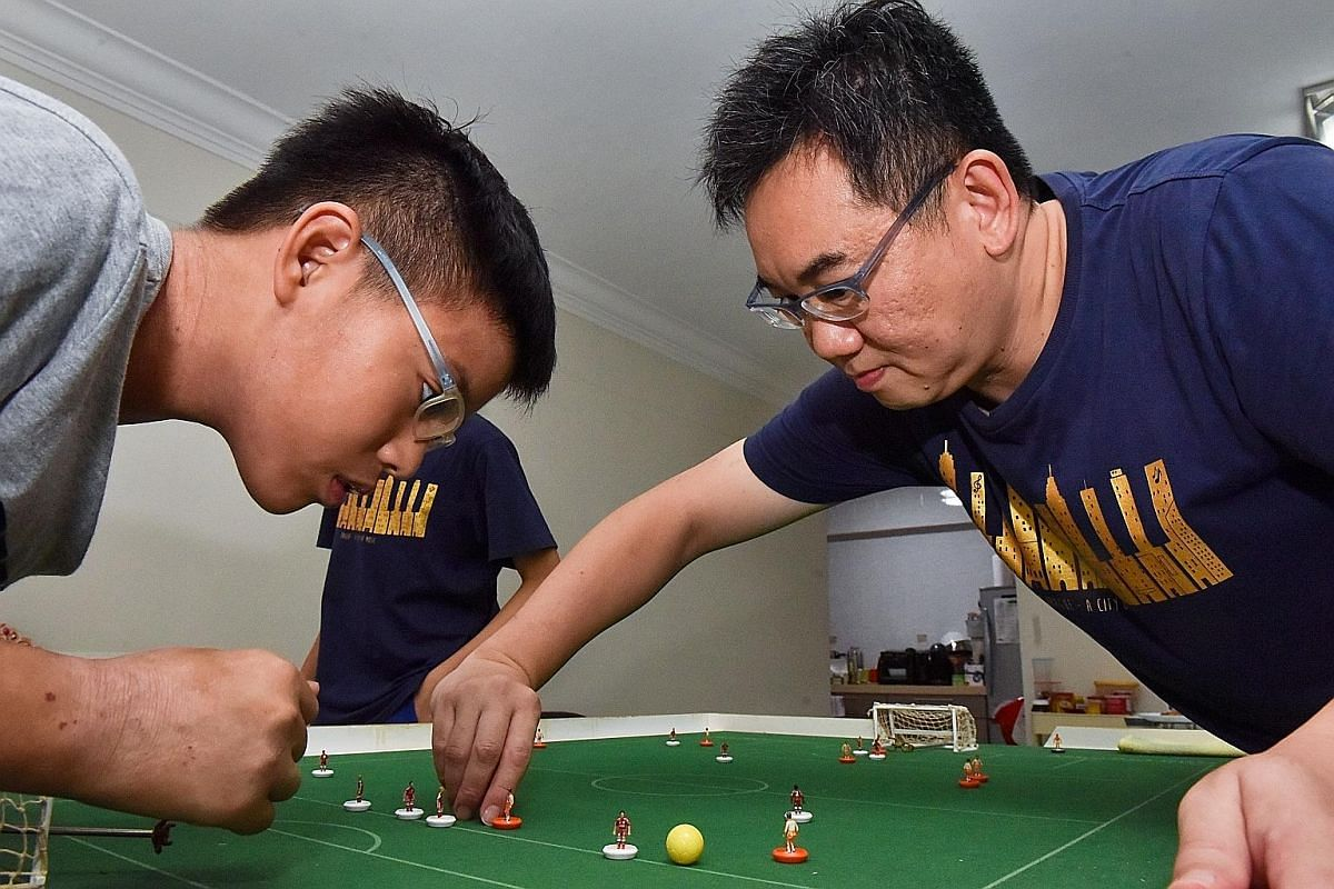 Above: A collection of table football figurines from the early 1980s to the present owned by Mr Lim and his family. The collection includes figurines with different bases, such as the oldest base called the Cereal Bowl and the Tchaaa Snake Base. Left