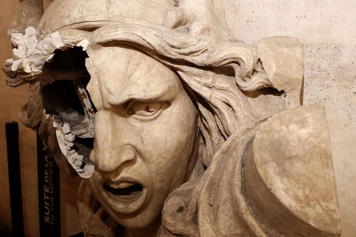 A vandalised statue of Marianne, a symbol of the French republic, inside the Arc de Triomphe.