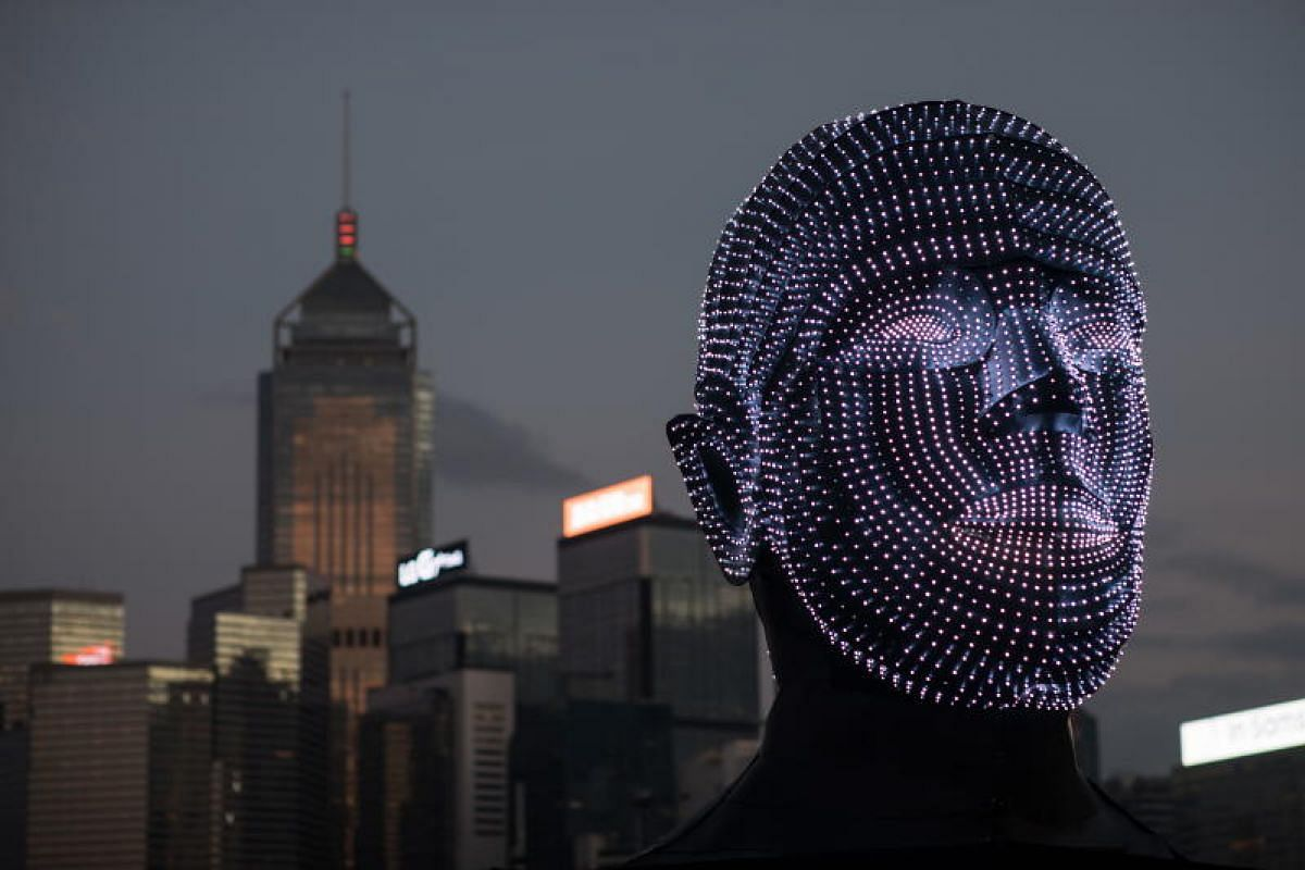A light installation by Hungarian artist Viktor Vicsek entitled 'Talking Heads' is displayed on the Central harbour waterfront in Hong Kong, China, December 3, 2018. PHOTO: EPA-EFE
