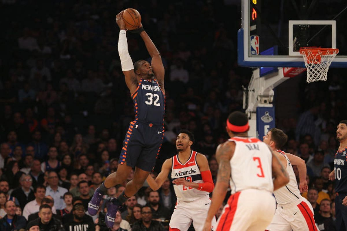 New York Knicks power forward Noah Vonleh (32) grabs a rebound over Washington Wizards small forward Otto Porter Jr. (22) during the first quarter at Madison Square Garden. Dec 3, 2018 in New York, NY, USA. PHOTO: USA TODAY SPORTS