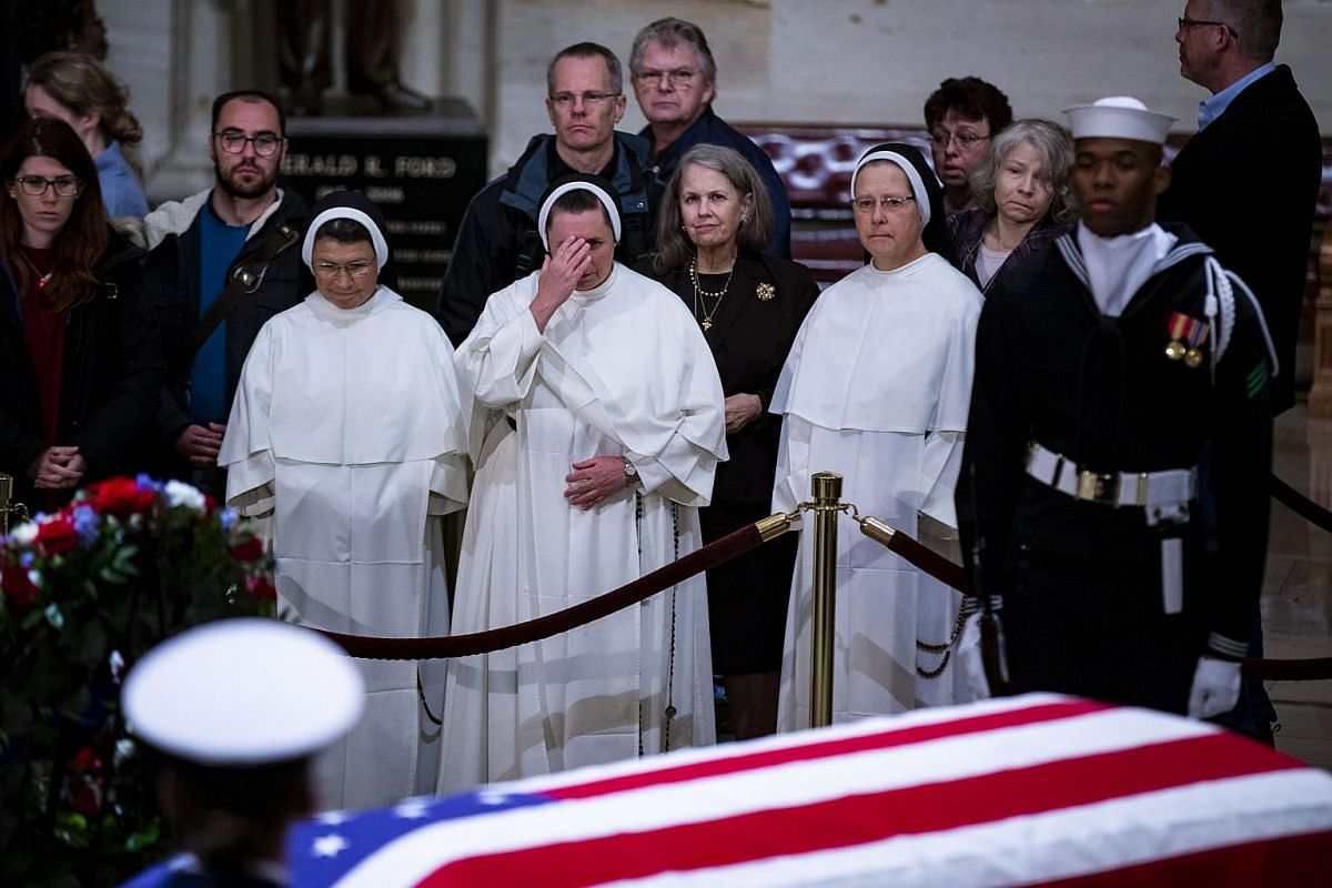 Members of the public, including nuns, pay their respects as former president George H. W. Bush lies in state at the Capitol Rotunda in Washington, DC, on Dec 3, 2018.