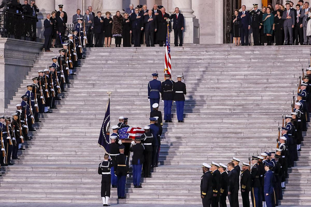 The casket of former US president George H. W. Bush is carried by a colour guard up the steps of the US Capitol in Washington, DC, on Dec 3, 2018.