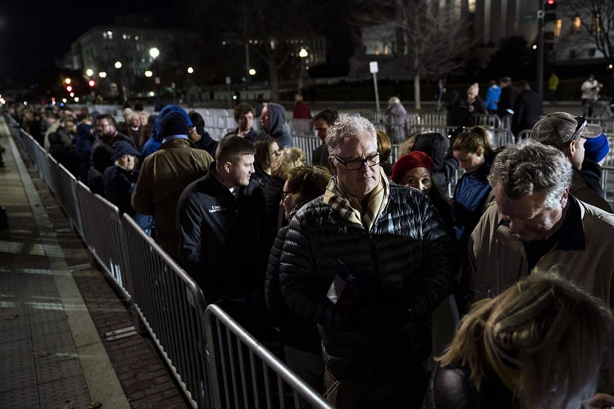 Mourners wait in line outside the Capitol to pay their respects to former president George H. W. Bush in Washington on Dec 3, 2018.