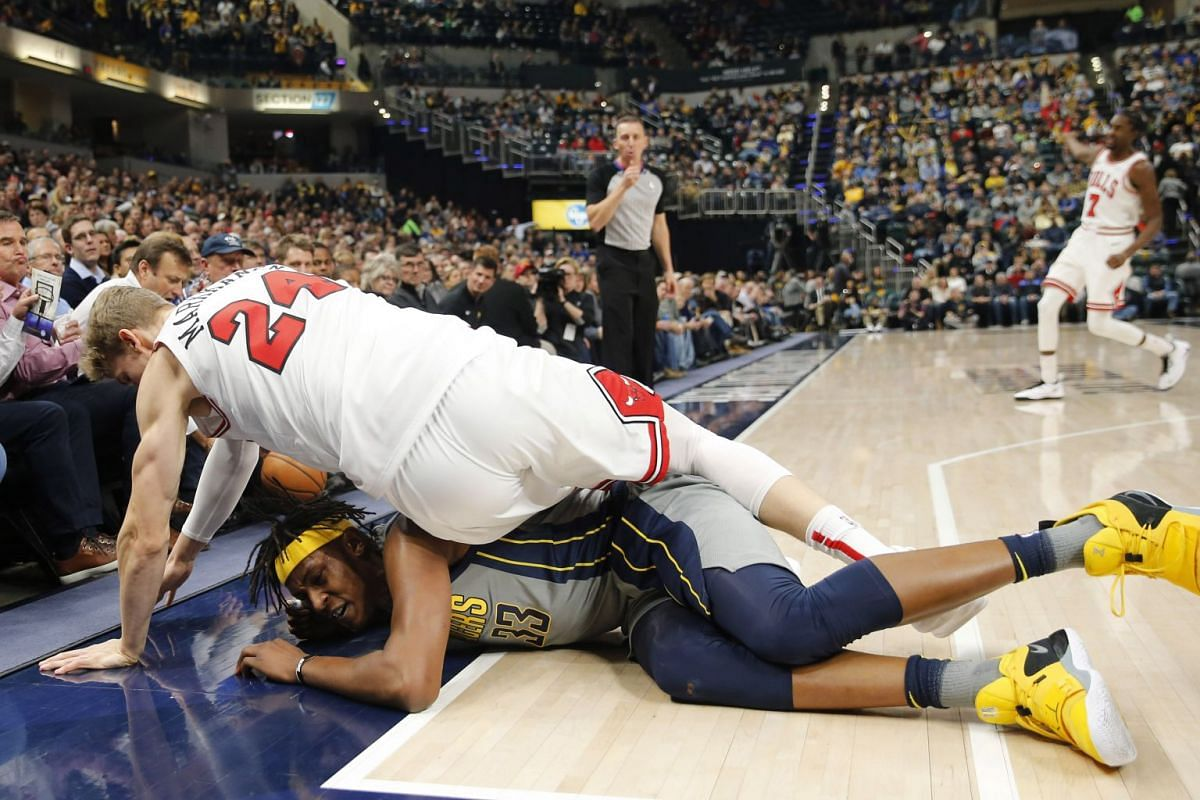 Indiana Pacers center Myles Turner (33) and Chicago Bulls forward Lauri Markkanen (24) fall out of bounds scrambling for a loose ball during the first quarter at Bankers Life Fieldhouse on Dec 4, 2018 in Indianapolis, IN, USA. PHOTO: USA TODAY SPORTS