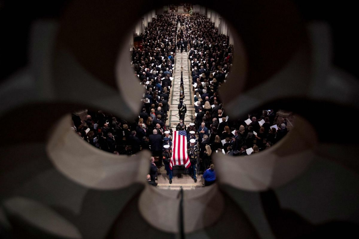 The casket of former president George H.W. Bush is carried by pall bearers following his state funeral at the Washington National Cathedral in Washington, DC December 5, 2018. PHOTO: POOL VIA AFP