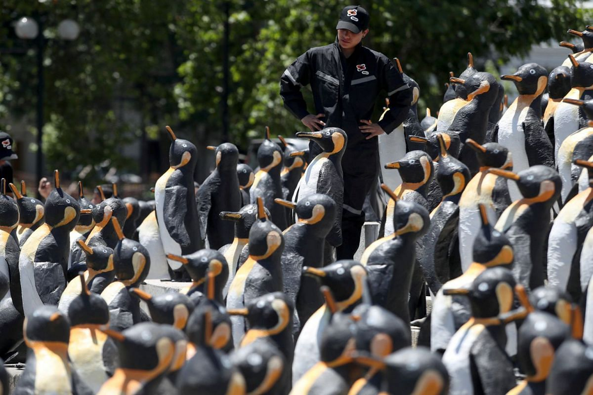 A man stands among recycled-materials penguin sculptures at a square as part of an environmental campaign in Santiago, Chile December 6, 2018. PHOTO: REUTERS