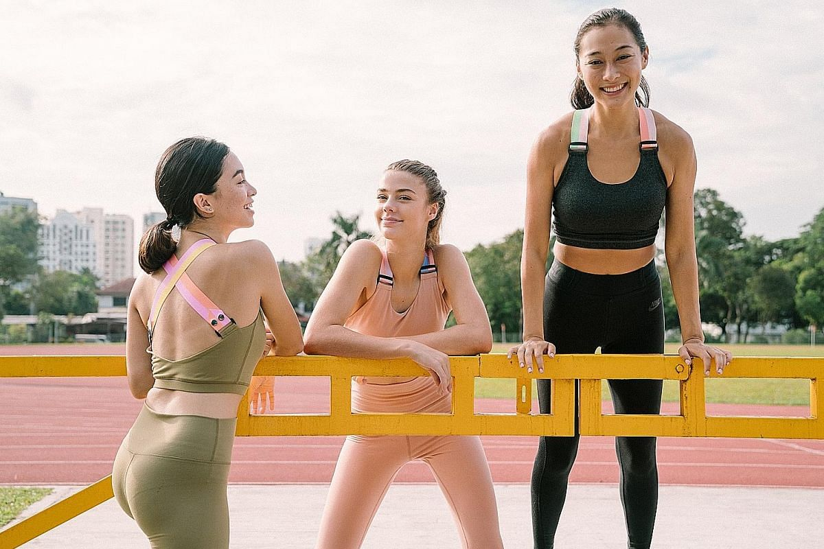 Local brand Project Sora has sports bras with funky straps that look more like crop tops, offering more coverage around the chest and torso. Far left: Outfyt founder Stephanie Colhag Yeo dressed in her label's sports bra, shorts, vest and cap. Left: