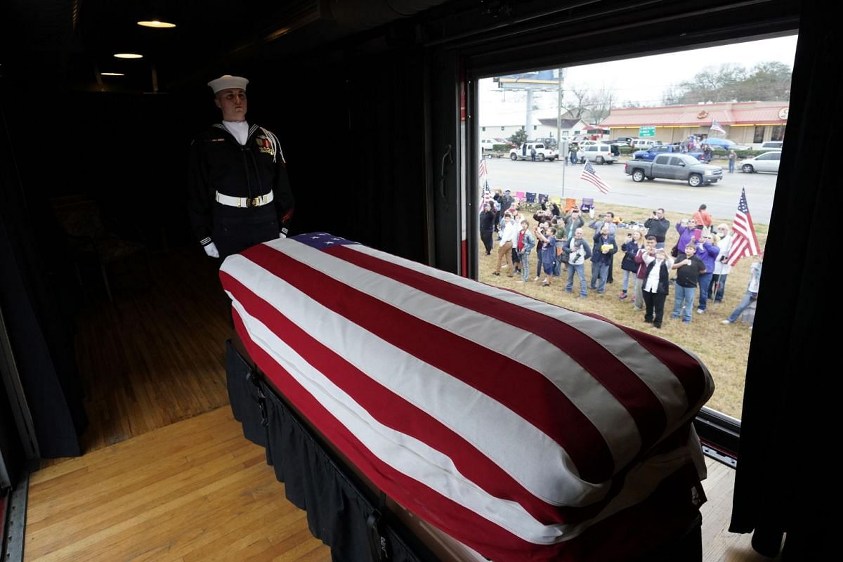 An honour guard stands over the casket of former president George H. W. Bush as the train travels the route from Spring to College Station, Texas, US.