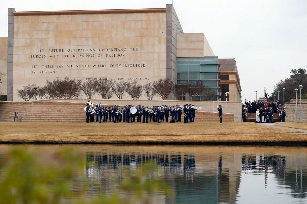 A military band plays as joint services honour guards carry the casket of former US president George H. W. Bush for burial at the George H. W. Bush Presidential Library and Museum in College Station, Texas, US.