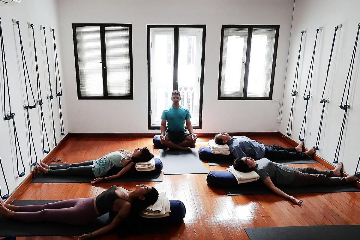 Mr Krishna Mohan (centre) leads a pranayama and meditation class at boutique fitness studio Level.