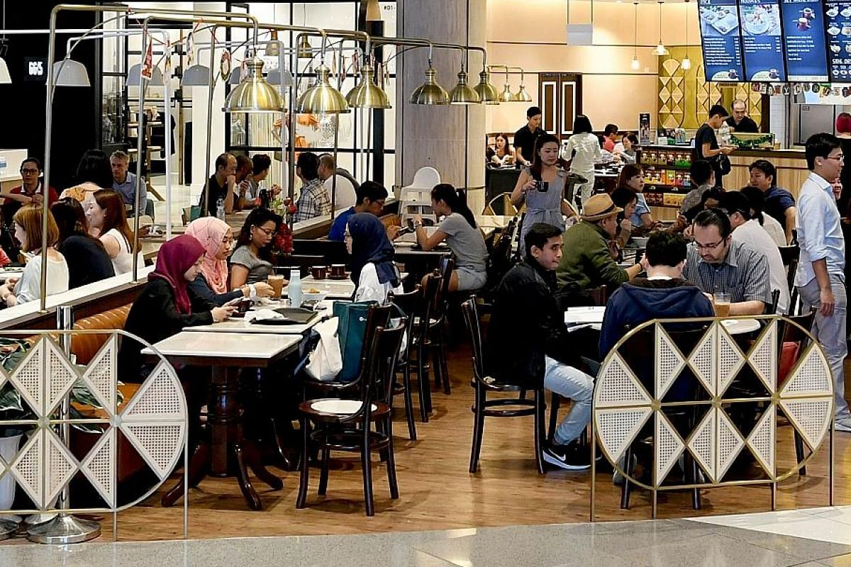 OldTown White Coffee's Suntec City outlet has a sleek look, with brass lights and textured light oak walls. (Above) Hideout by The Local Box at The Heeren has a minimalist look and its menu is an extension of The Local Box cafe's best-selling dishes.
