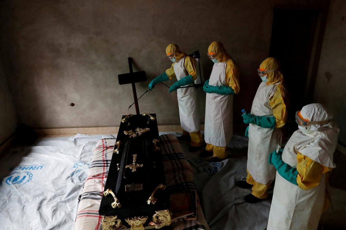 A healthcare worker sprays the room during the funeral of Kavugho Cindi Dorcas who was suspected to have died of Ebola in Beni, North Kivu Province of the Democratic Republic of Congo, on Dec 9, 2018.