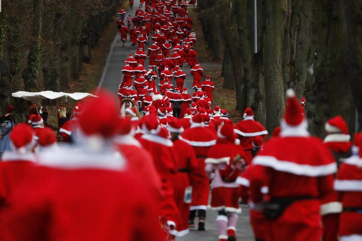 People dressed as Saint Nicholas race through the streets of Michendorf, near Berlin, on Dec 9, 2018.