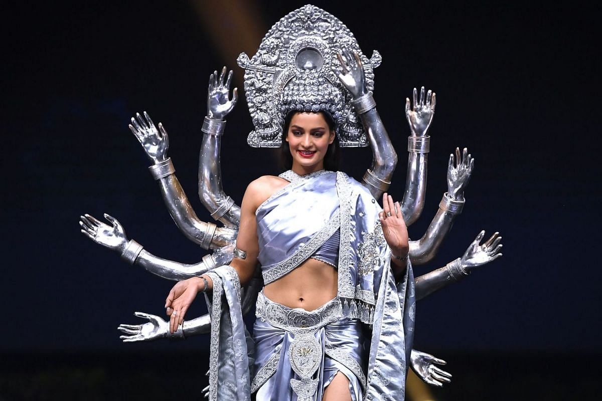 Miss Nepal, Manita Devkota, walks on stage during the 2018 Miss Universe national costume presentation in Chonburi province on Dec 10, 2018.