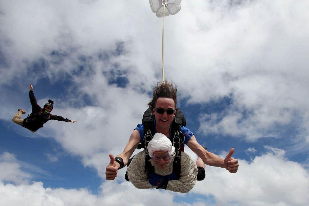 This handout taken on December 9, 2018 and released by SA Skydiving shows 102-year-old great-grandmother Irene O'Shea during her skydive tandem jump over Wellington in South Australia. She is believed to have become the world's oldest skydiver afte