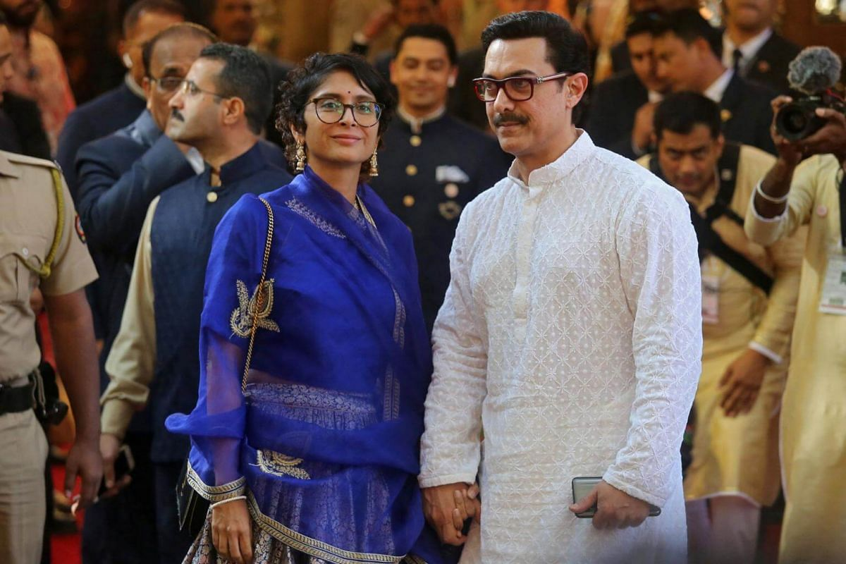 Bollywood actor Aamir Khan and his wife Kiran Rao arrive to attend the wedding ceremony in Mumbai, on Dec 12, 2018.