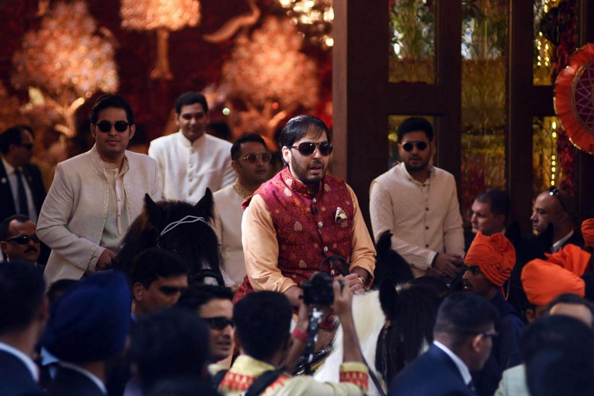 Businessman Mukesh Ambani's sons Akash (left) and Anant ride horses as they arrive with the marriage procession in Mumbai, on Dec 12, 2018.