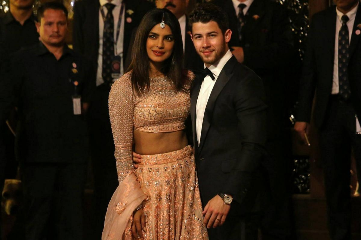 Actress Priyanka Chopra and her husband Nick Jonas arrive to attend the wedding ceremony in Mumbai, on Dec 12, 2018.