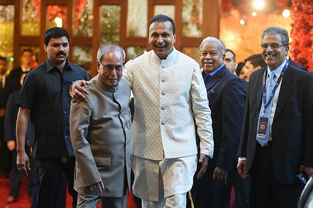 Former Indian president Pranab Mukherjee (left) and businessman Anil Ambani attend the wedding ceremony in Mumbai, on Dec 12, 2018.