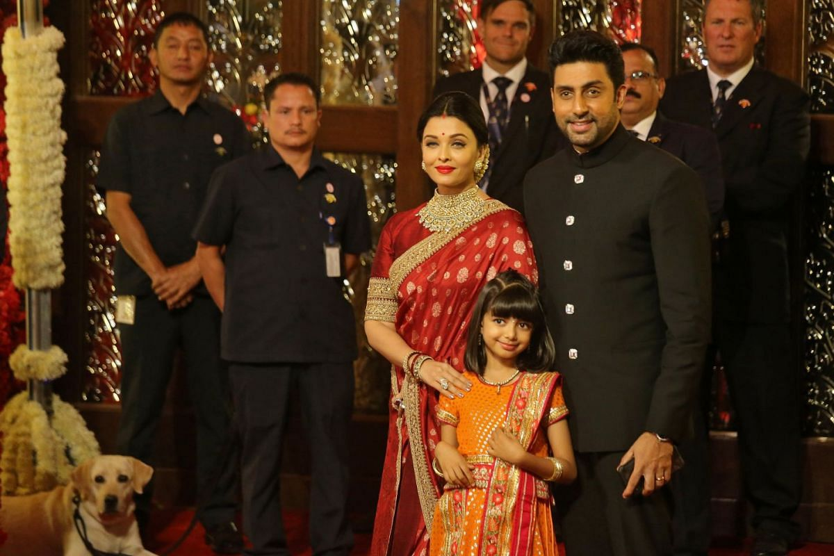 Bollywood actor Abhishek Bachchan, his wife actress Aishwarya Rai and their daughter Aaradhya at the wedding ceremony.