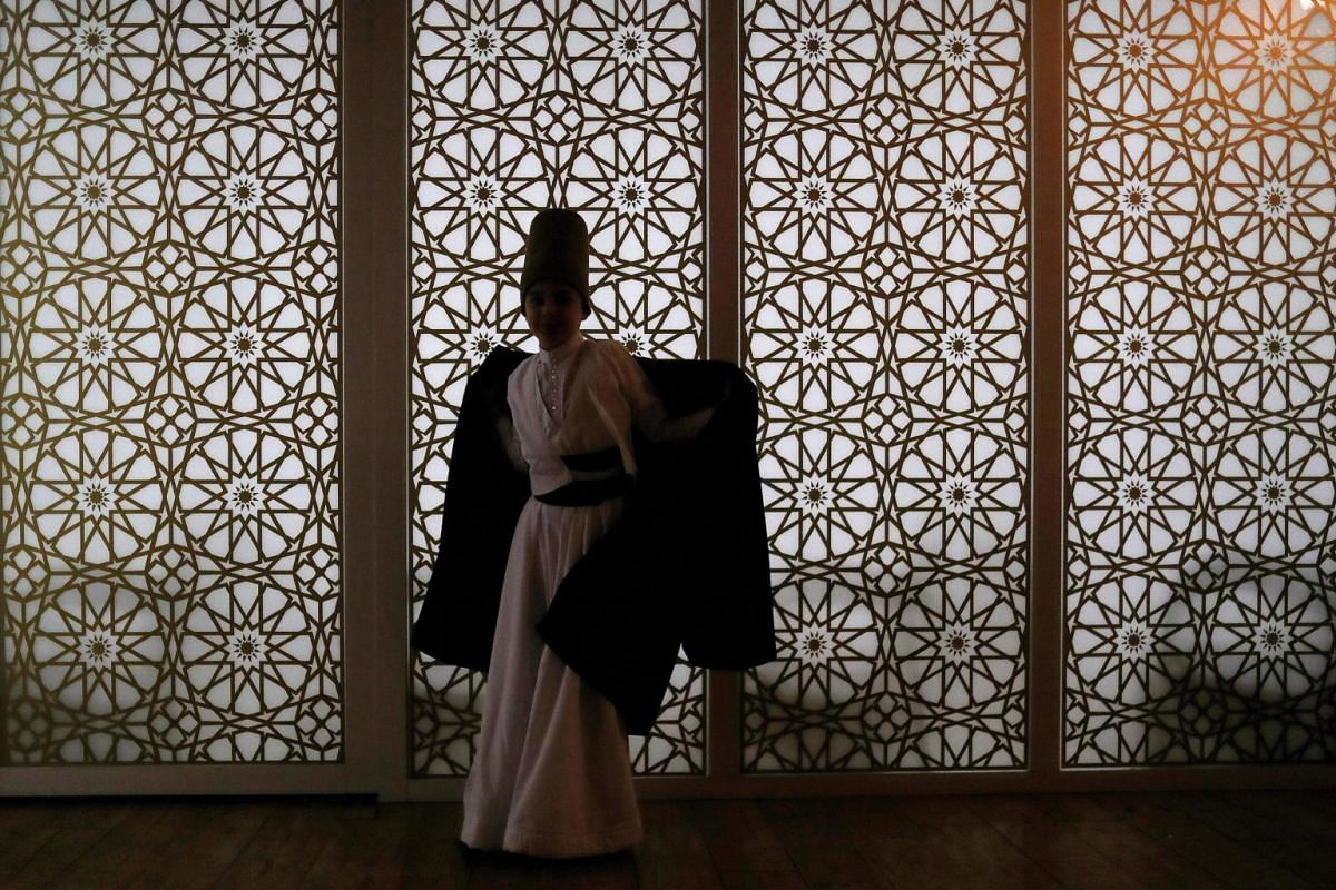 """A dervish prepares for a """"Seb-i Arus"""" ceremony at the Bahariye theatre in Istanbul, Turkey, on Dec 12, 2018."""