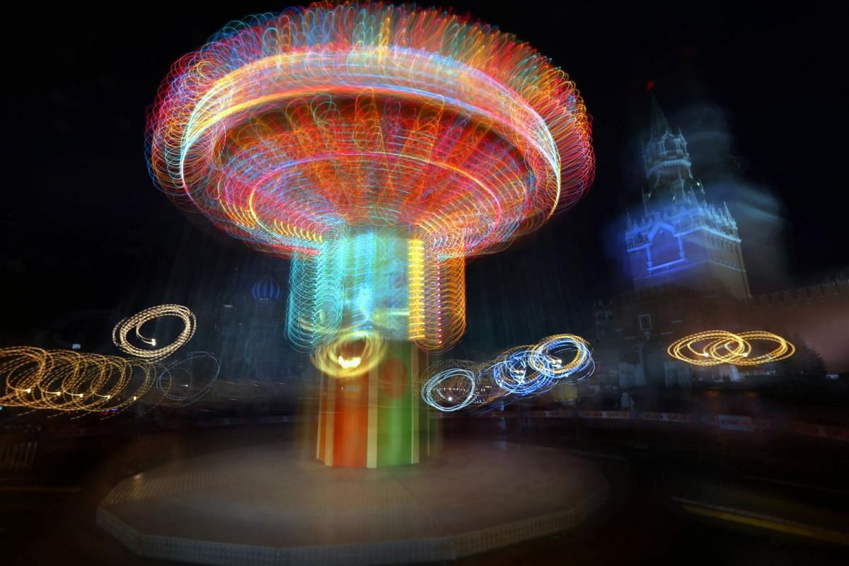A long-exposure shows a carousel turning in Red Square as it is decorated for the New Year and Christmas holidays in the centre of Moscow, Russia, on Dec 12, 2018.