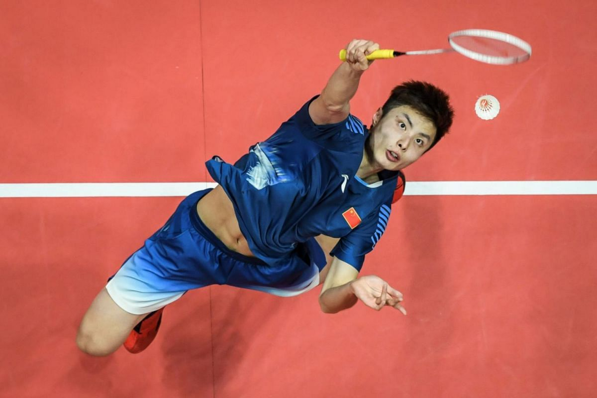 Shi Yuqi of China hits a return against Son Wan Ho of South Korea during their men's singles first round match at the 2018 BWF World Tour Finals of badminton in Guangzhou, south China's Guangdong province, on Dec 12, 2018.