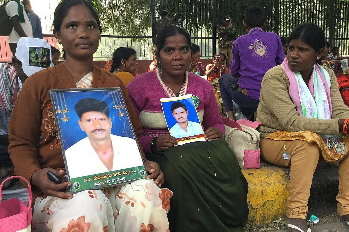 Above: Widows Idamma (left) and Kavitha, with photos of their farmer husbands who committed suicide, resting after a 3km walk at a New Delhi rally last month. Below: Tamil Nadu farmers came with bones and skulls of farmers who they claimed had commit