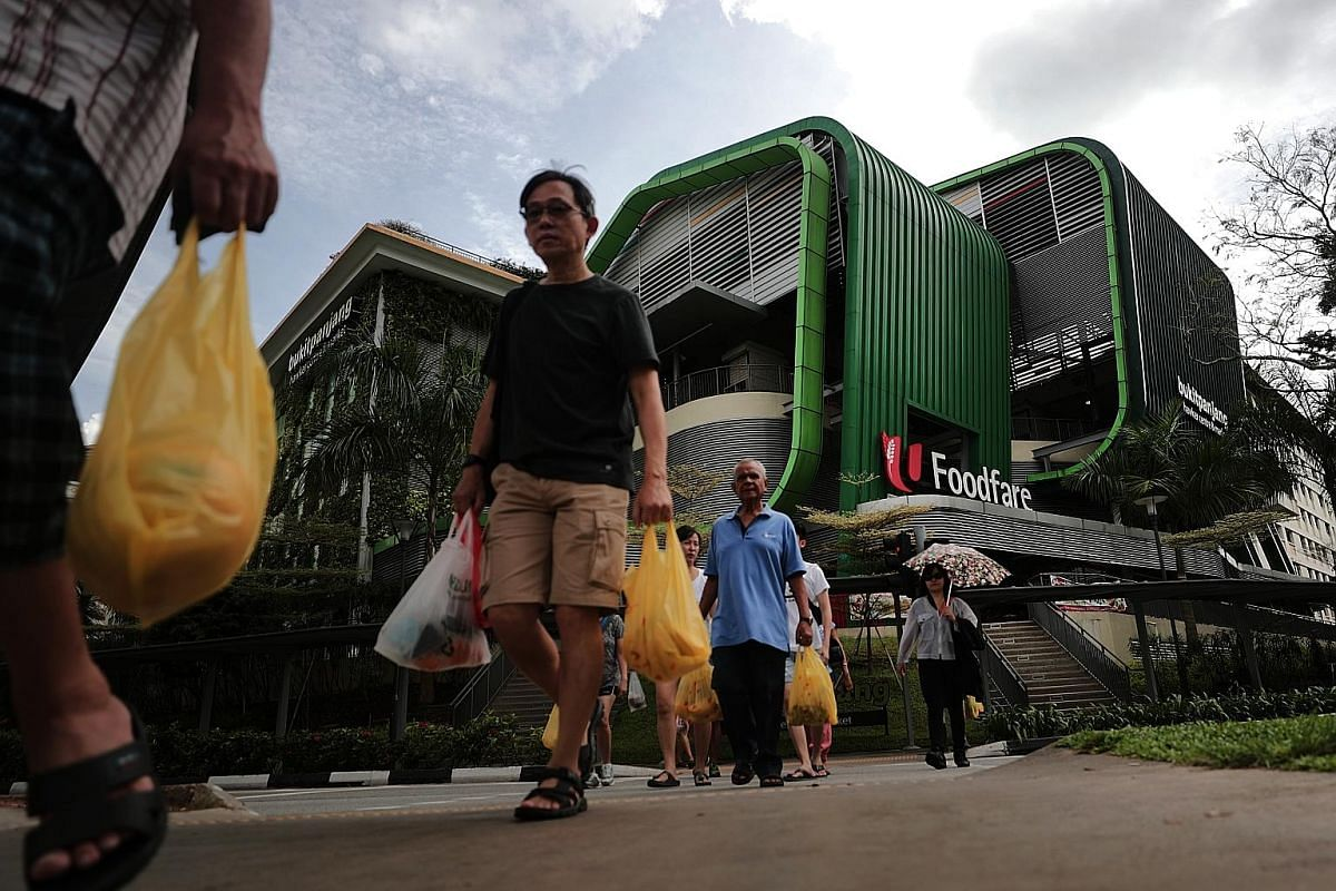 Left and top: Wet market stallholders at the Bukit Panjang Hawker Centre and Market have been given until April next year to decide whether to stay on after nearly three years of sluggish sales. Above: The wet market at the centre is on the second fl