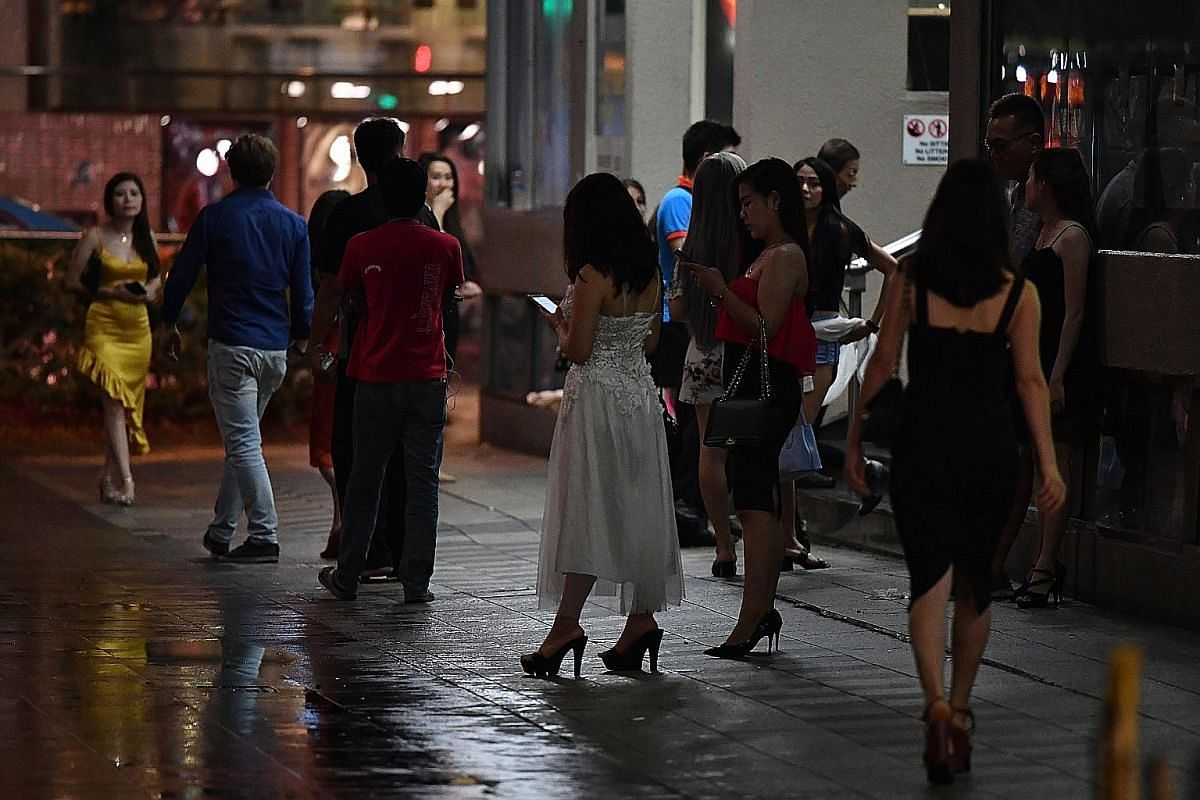 The scene late at night outside Orchard Towers. Philippine Embassy officials suspect a syndicate in Singapore could be behind the trafficking of Filipino women here.