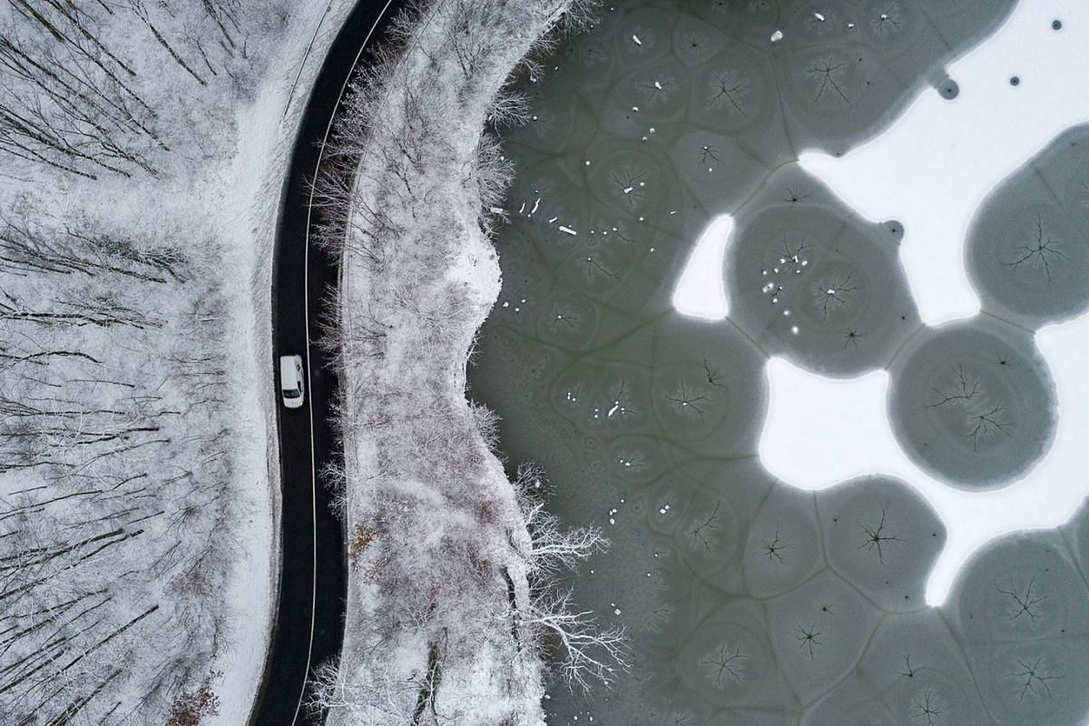 An aerial photograph shows the frozen and partly snow-covered fishing lake in Komlo-Sikonda, some 225 km south of Budapest, Hungary, December 15, 2018.