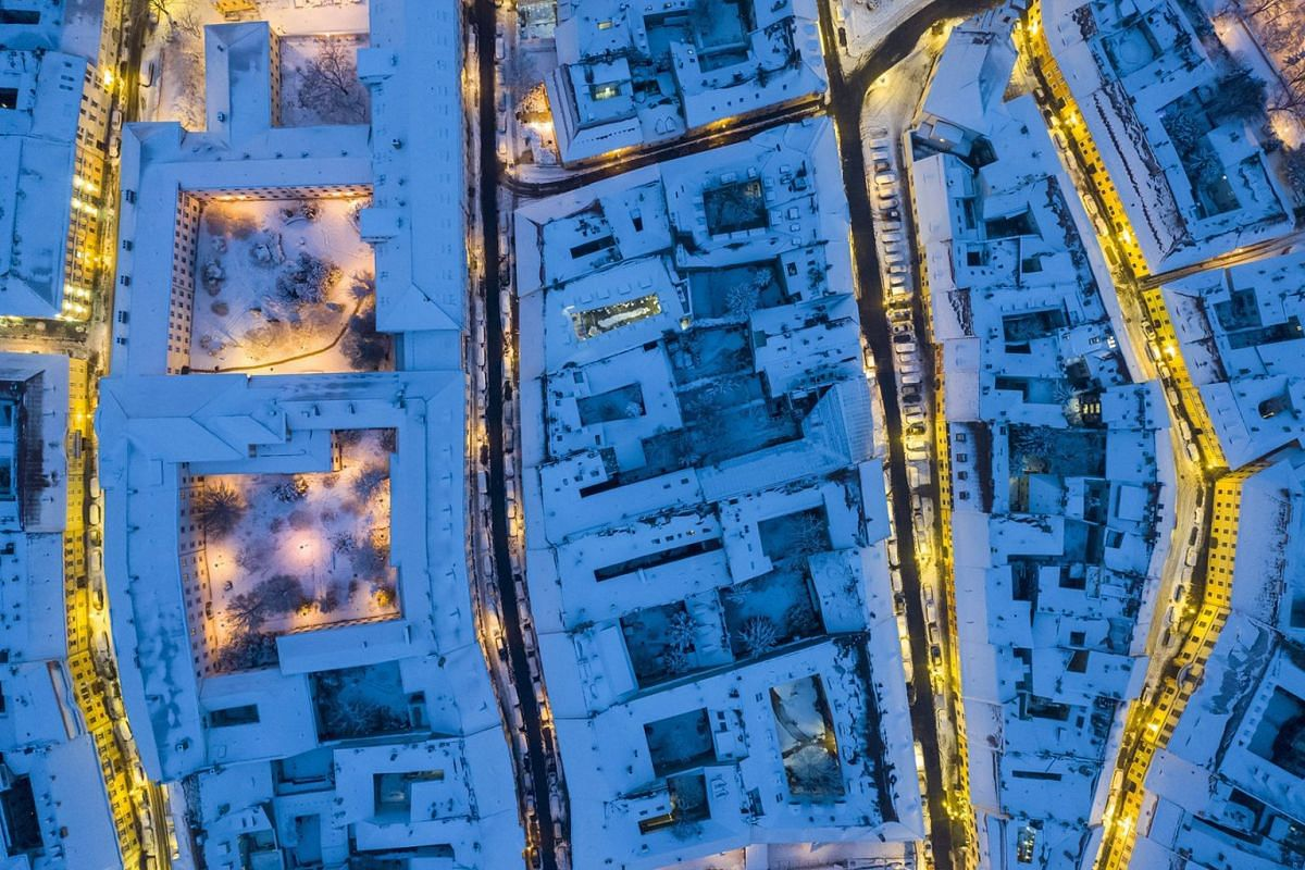 An image taken with a drone shows an aerial view of snow covered houses in the Castle District in Budapest, Hungary, December 16, 2018.