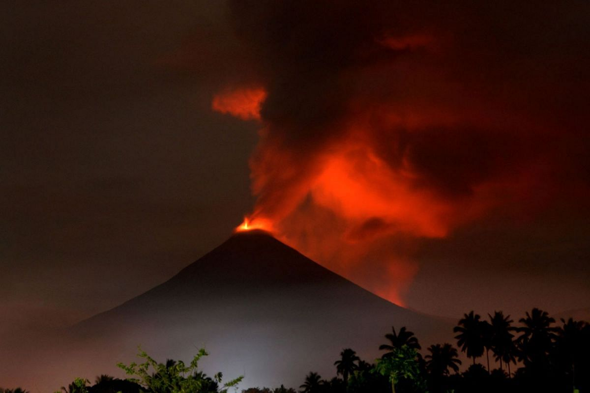 Mount Soputan volcano spews hot ash during an eruption as seen from Silian Tiga village in South East Minahasa, North Sulawesi, Indonesia, December 16, 2018.