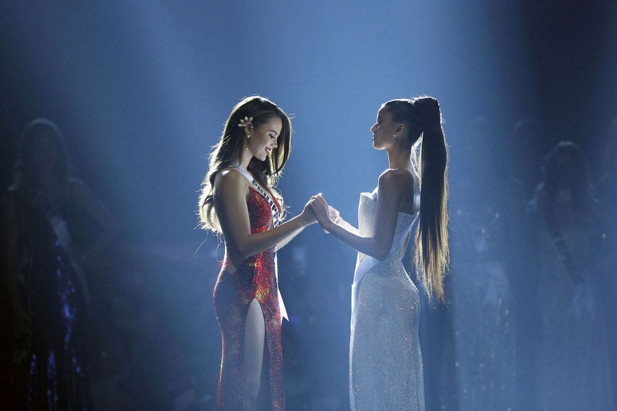Miss Philippines Catriona Gray and Miss South Africa Tamaryn Green hold hands as they wait for the winner to be announced during the final round of the Miss Universe pageant in Bangkok, Thailand, December 17, 2018.