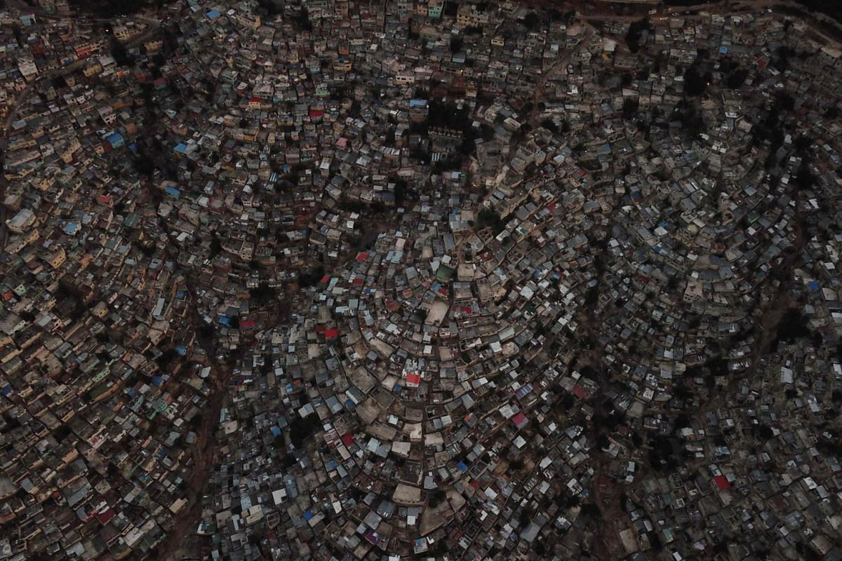 Aerial view at nightfall of houses in the neighbourhoods of Jalousie (left), Philippeaux (centre) and Desermites, in the commune of Petion Ville, Port-au-Prince, Haiti, on Dec 16, 2018.