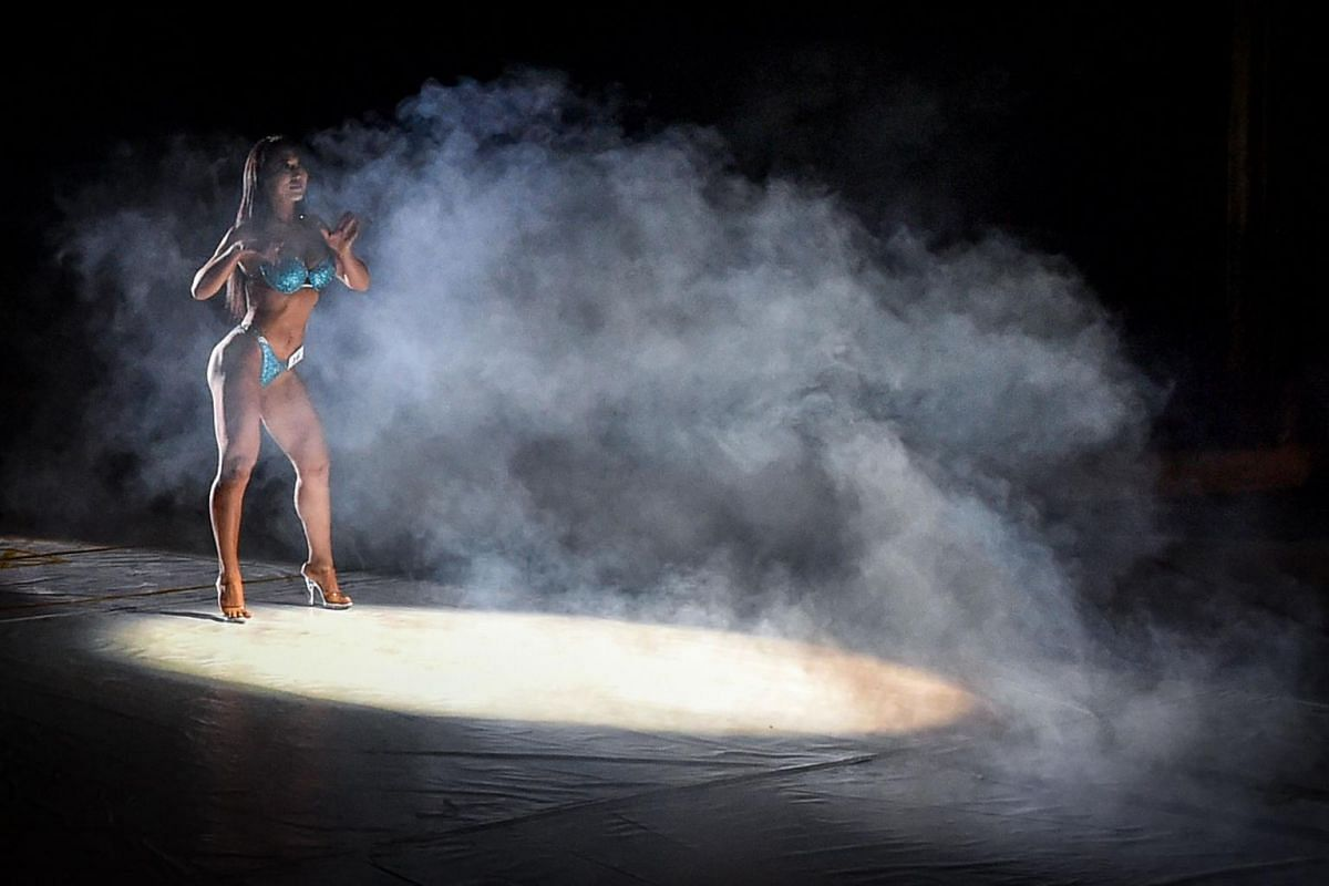 A participant takes part in the Bikini fitness bodybuilding contest in Bishkek, Kyrgyzstan, on Dec 16, 2018.