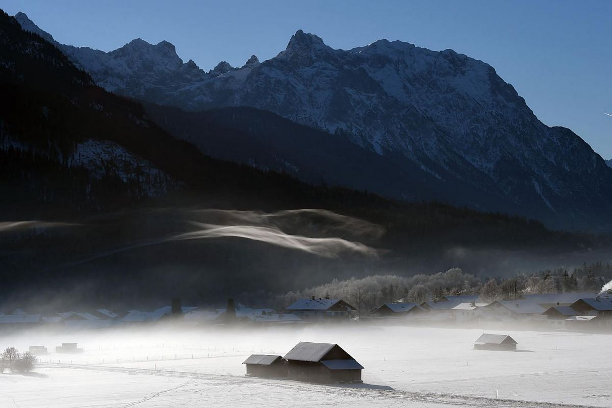 Fog passes through the valley near the village of Wallgau near Garmisch-Partenkirchen, southern Germany, during sunny winter weather with temperatures of minus three degrees celsius on Dec 18, 2018.