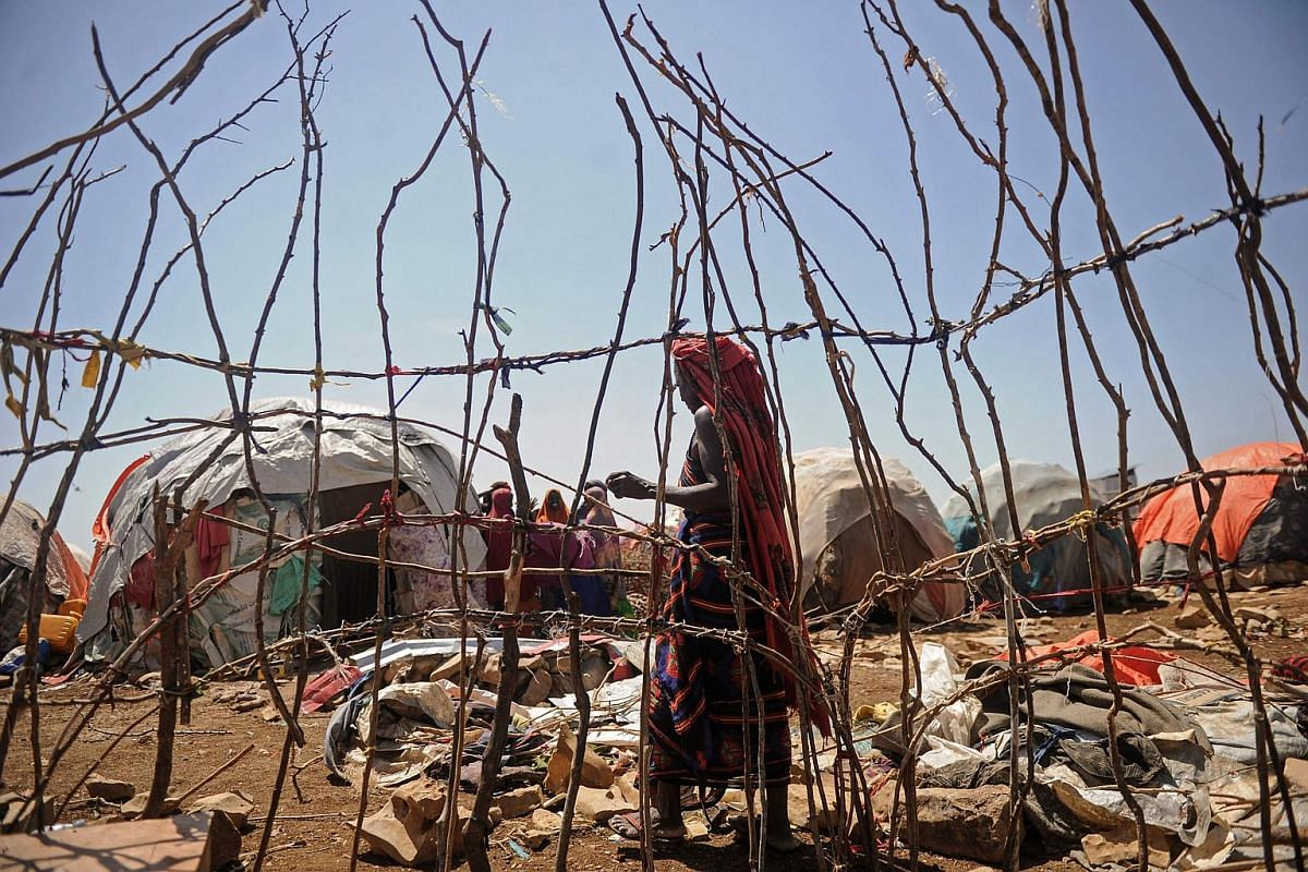 A Somali woman walks in an internally displaced people camp where hundreds of people recently fled from US airstrikes against al Shebab, in Baidoa, autonomous South West State of Somalia, on Dec 18, 2018.