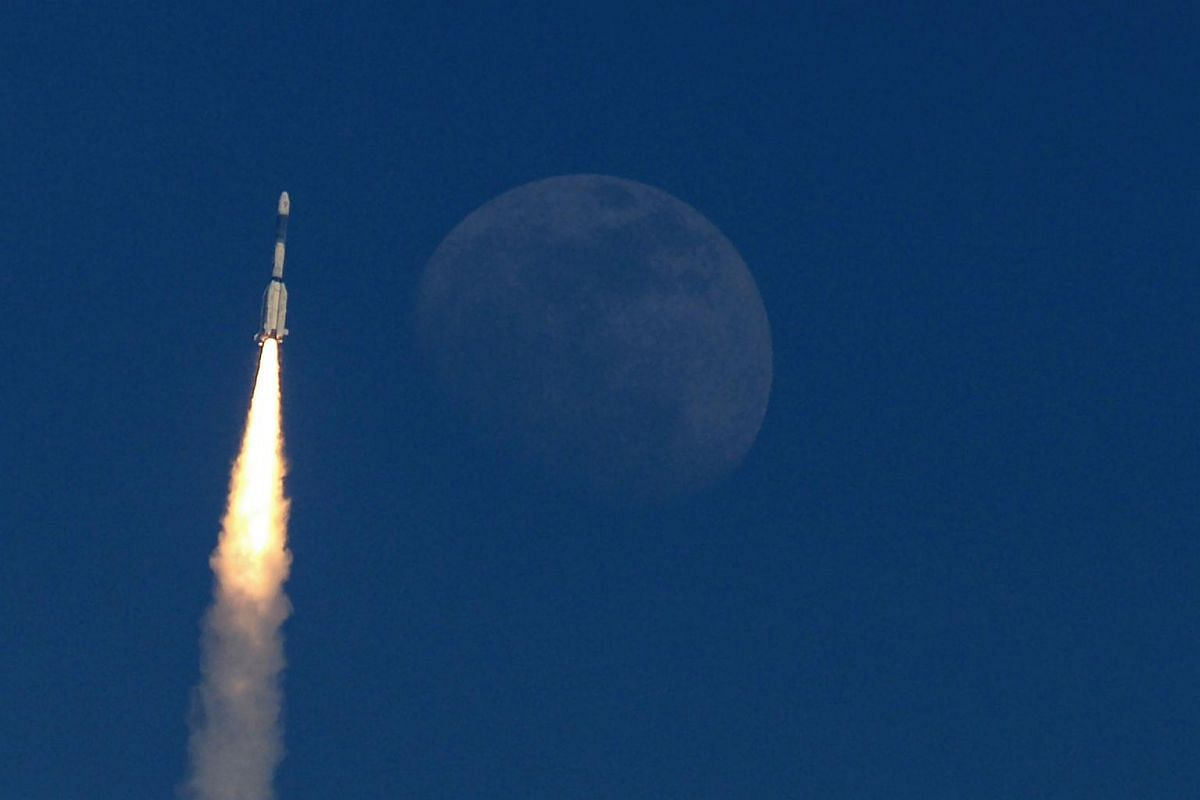 The Indian military communication satellite GSAT-7A is pictured next to the moon as it is launched into orbit on the Indian Space Research Organisation's Geosynchronous Satellite Launch Vehicle in Sriharikota in the state of Andhra Pradesh on Dec 19,