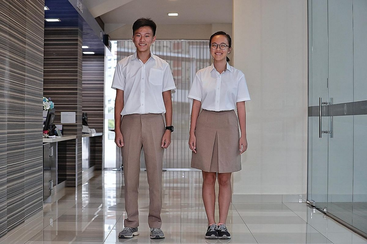 Jonathan Teo Jun Rui, 16, and Keesha Tan Kai Xuan, 17, of Tampines Meridian JC - one of the four merged schools - in their new uniforms.