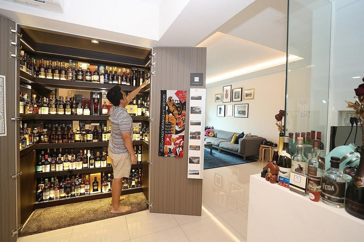 Ms Candy Low (with her daughter Claris Fong) and her husband Andy Fong, who is not in the photo, have a bar in their executive condominium apartment where they host friends and relatives for drinks. Mr Colin Ong turned one floor of his bungalow into