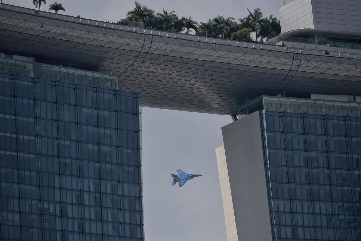 The Republic of Singapore Air Force (RSAF) flying an F-15 fighter jet on June 5, 2018 to give reporters a preview of this year's aerial display for the National Day Parade. The jet is painted blue with the number 50 to celebrate the RSAF's golden