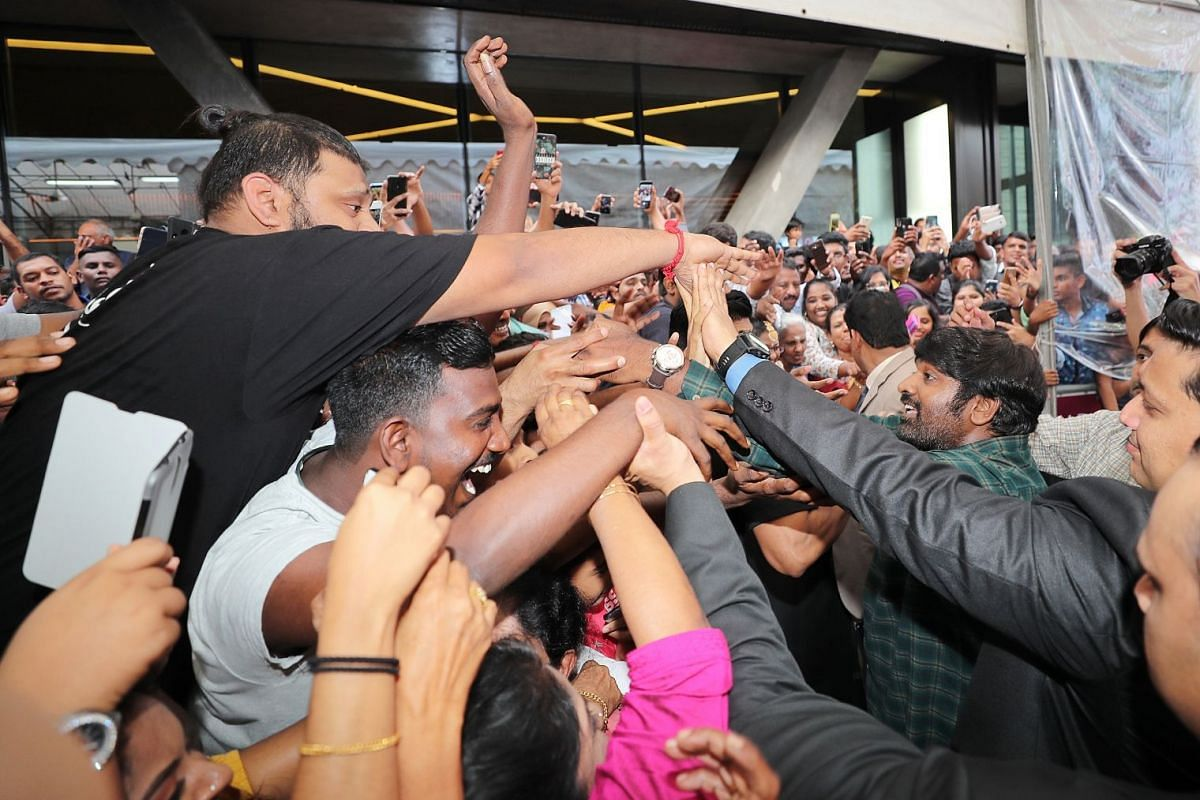 Famous Indian film actor, producer and screenwriter of the Tamil Film Industry Vijay Sethupathi is mobbed by fans during his visit to Singapore on Dec 7, 2018 to launch a new Malabar Gold & Diamonds outlet at 121 Serangoon Road. He met the fans and s
