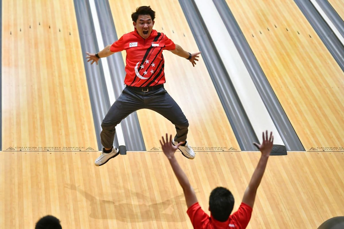 Muhammad Jaris Goh celebrates with a star-jump after his strike in the men's trios event won another bowling bronze medal for Singapore on Aug 23, 2018, at the Asian Games in Indonesia.