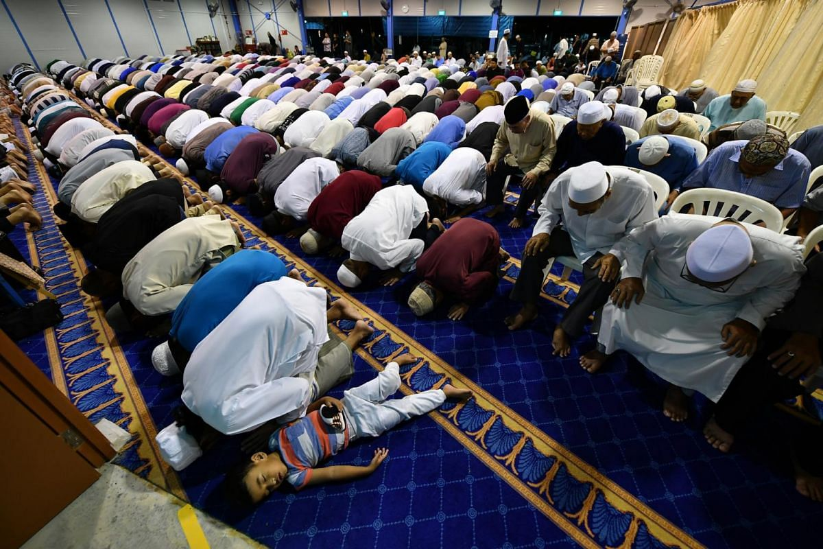 Muslims performing special evening prayers on May 16, 2018, the first night of the holy fasting month of Ramadan, at the temporary site of Masjid Darul Ghufran in Tampines. Muslims in Singapore began fasting on May 17 and celebrate Hari Raya Puasa on