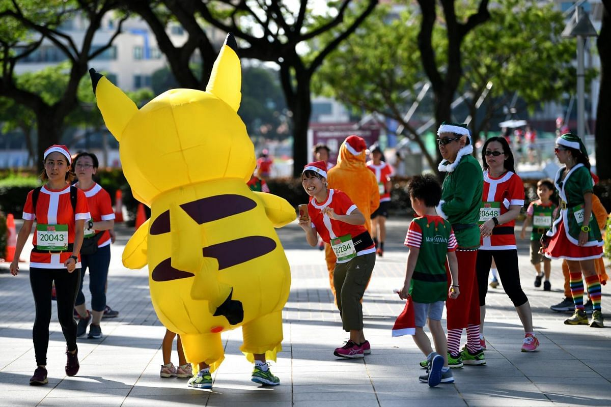 Mr Henry Tan, 38, a Singapore Armed Forces regular serviceman, dressed up as Pikachu at the fifth edition of Santa Run for Wishes 2018 organised by Make-A-Wish Singapore to raise funds for children with critical illnesses, at Singapore Sports Hub on
